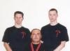 Si Gung Hubert Wolf mit seinen frischgebackenen Rahlstedter Schwarzgurten Si Hing Manuel und Si Hing Tobias 2001